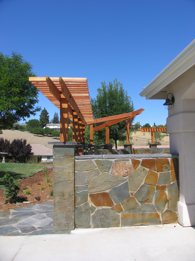 flagstone masonry and redwood arbor