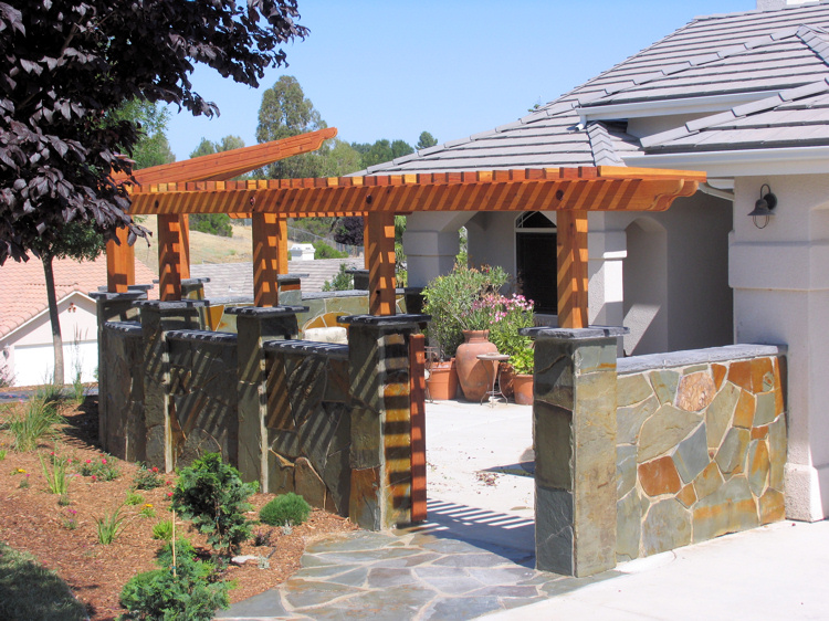 Flagstone masonry and decorative arbor